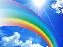 Rainbow on blue sunny sky Stock Photos