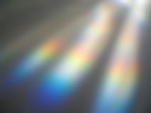 Rainbow Blur. Refracted light and rainbows blurred on a painted white table top royalty free stock photo