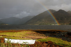 Rainbow and boat Stock Images