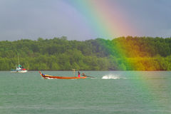 Rainbow and boat on the river at Koh Kho Khao Royalty Free Stock Photo