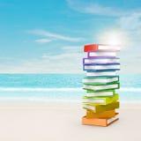 Rainbow books near beach Stock Images