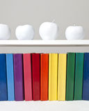 Rainbow Books and White Apples Royalty Free Stock Images