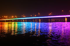 Rainbow bridge. Vivid and colorful rainbow bridge at DADAOCHENG harbor in the night in Taipei city, Taiwan (ROC Royalty Free Stock Photo