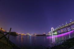 Rainbow Bridge against Tokyo City Lights Royalty Free Stock Photos
