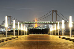 Rainbow Bridge during Energy Conservation. Rainbow Bridge in Tokyo, Japan without it's signature lighting during energy conservation efforts dubbed setsuden in Stock Images