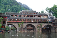 Rainbow Bridge, Fenghuang, China. Old Rainbow bridge over Tuo river in the historic Fenghuang in China. A famous tourist attraction Royalty Free Stock Image