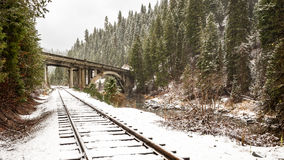 Rainbow bridge in Idaho with train tracks in winter stock photo