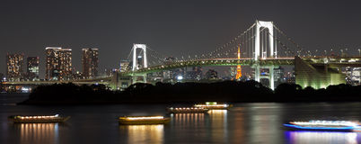 Rainbow Bridge at Night. The Rainbow Bridge in Tokyo Japan at night with the skyline and Tokyo Tower int he background Stock Image