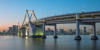 Rainbow bridge at night with Tokyo tower in background Royalty Free Stock Image