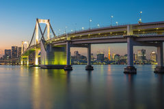 Rainbow bridge at night with Tokyo tower in background Stock Photography