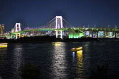 Rainbow bridge in Odaiba, Tokyo, Japan. Rainbow Bridge connecting Tokyo city with Odaiba Island was completed in 1993 and it soon became one of the city Royalty Free Stock Photography