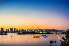 Rainbow Bridge Odiba under sunset, Tokyo Royalty Free Stock Images