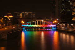 Rainbow bridge at singapore. Beautiful rainbow bridge at singapore at night, along with singapore river. in the background is Marina bay sand. Such a beautiful Stock Images