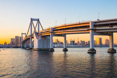 Rainbow Bridge at sunset in Tokyo, Japan Royalty Free Stock Image