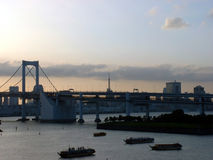 Rainbow Bridge - Tokyo, Japan. Wide view of Tokyo Bay and Rainbow bridge from Odaiba. In the back - Tokyo Tower Stock Image