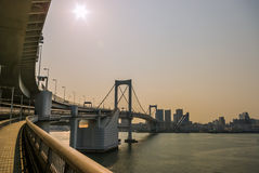 Rainbow Bridge in Tokyo. Wide angle view taken of the Rainbow Bridge looking toward the Tokyo skyline Stock Photography