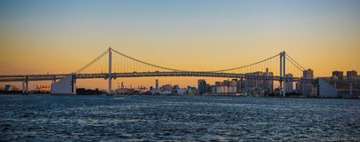 Rainbow bridge Tokyo romantic sunset panorama stock images