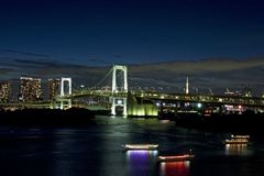Rainbow bridge and tokyo tower at night Stock Photo