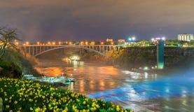 The Rainbow Bridge between USA and Canada at Niagara Falls. Night scene stock image