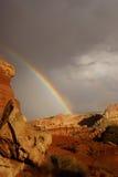 Rainbow and brief dramatic sunshine Stock Photography