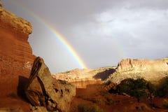 Rainbow and brief dramatic sunshine Royalty Free Stock Photo