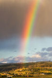 Rainbow. A bright rainbow over rural Tasmania royalty free stock photo