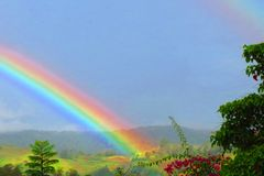 Rainbow. A brightly colored rainbow in the tropical island of Papua New Guinea Stock Photo