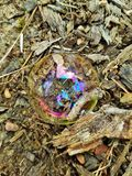Rainbow on bubble. On ground Stock Images