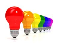 Rainbow bulb over white background Stock Images