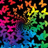 Rainbow butterflies. Swirl on a black background Royalty Free Stock Photo