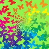 Rainbow butterflies. Swirl on green background Royalty Free Stock Photos