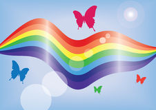 Rainbow colours. Rainbow coloured pattern with sun flare, butterflies and blue background Stock Photography