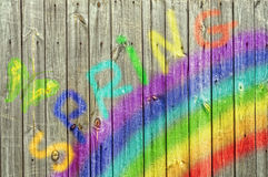 Rainbow and butterfly on wood  background Stock Photography