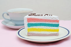 Rainbow cake with coffee Royalty Free Stock Images