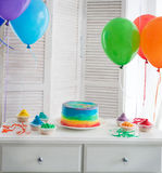 Rainbow cake and cupcakes on the Birthday party Royalty Free Stock Images