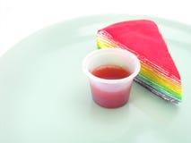 Rainbow cake and strawberry souce. On white background Stock Image