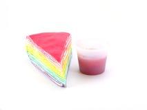 Rainbow cake and strawberry souce. On white background Stock Photography