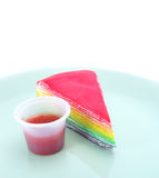 Rainbow cake and strawberry souce Royalty Free Stock Images