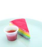 Rainbow cake and strawberry souce. On white background Royalty Free Stock Images