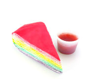Rainbow cake and strawberry souce on white background Royalty Free Stock Photography
