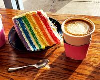 Free Rainbow Cake With Sprinkles, Cappucino, Spoon In Sunlight Stock Images - 169126564