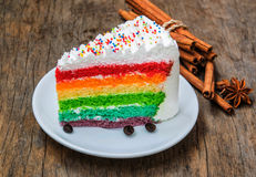 Rainbow  cake  on  wood background Royalty Free Stock Images