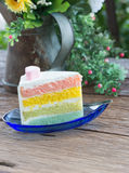 Rainbow cake on wood background Royalty Free Stock Photography