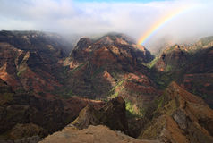 Rainbow canyon. Rainbow in Waimea Canyon on Kauai, Hawaii Royalty Free Stock Photos