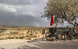 Rainbow in Cappadocia. The cart with the red and the tree flagoi Royalty Free Stock Photo