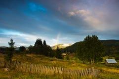 Rainbow in the Carpathians. Zaroslyak village in the Carpathian Mountains, Ukraine, Fall 2013 Stock Photography