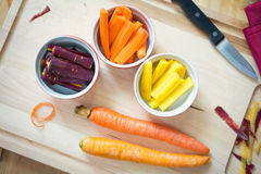 Rainbow Carrots in slices in cups Stock Photography