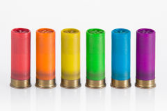 Rainbow cartridge. Six hunting cartridge in line, each one in a colour of the rainbow isolated in white Royalty Free Stock Photo