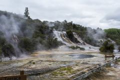 Rainbow Cascade silica terraces and Map of Africa geothermal pool. Geothermal Orakei Korako park in New Zealand Royalty Free Stock Images