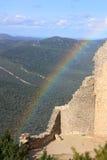 Rainbow on castle of Peyrepertuse in Pyrenees, France Stock Photos